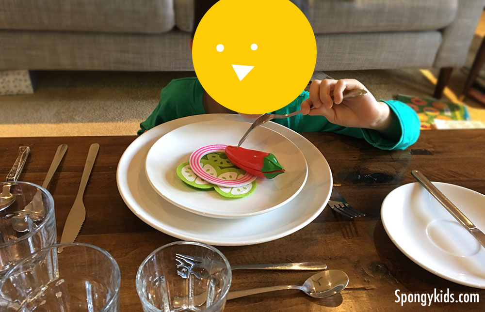 Table Setting and Manners for Kids Pretending to eat salad