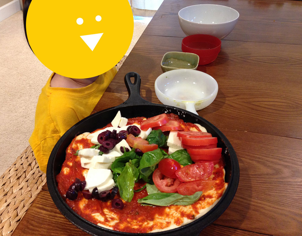Making Your Own Pizza with Kids Tomato basil olive and mozzarella