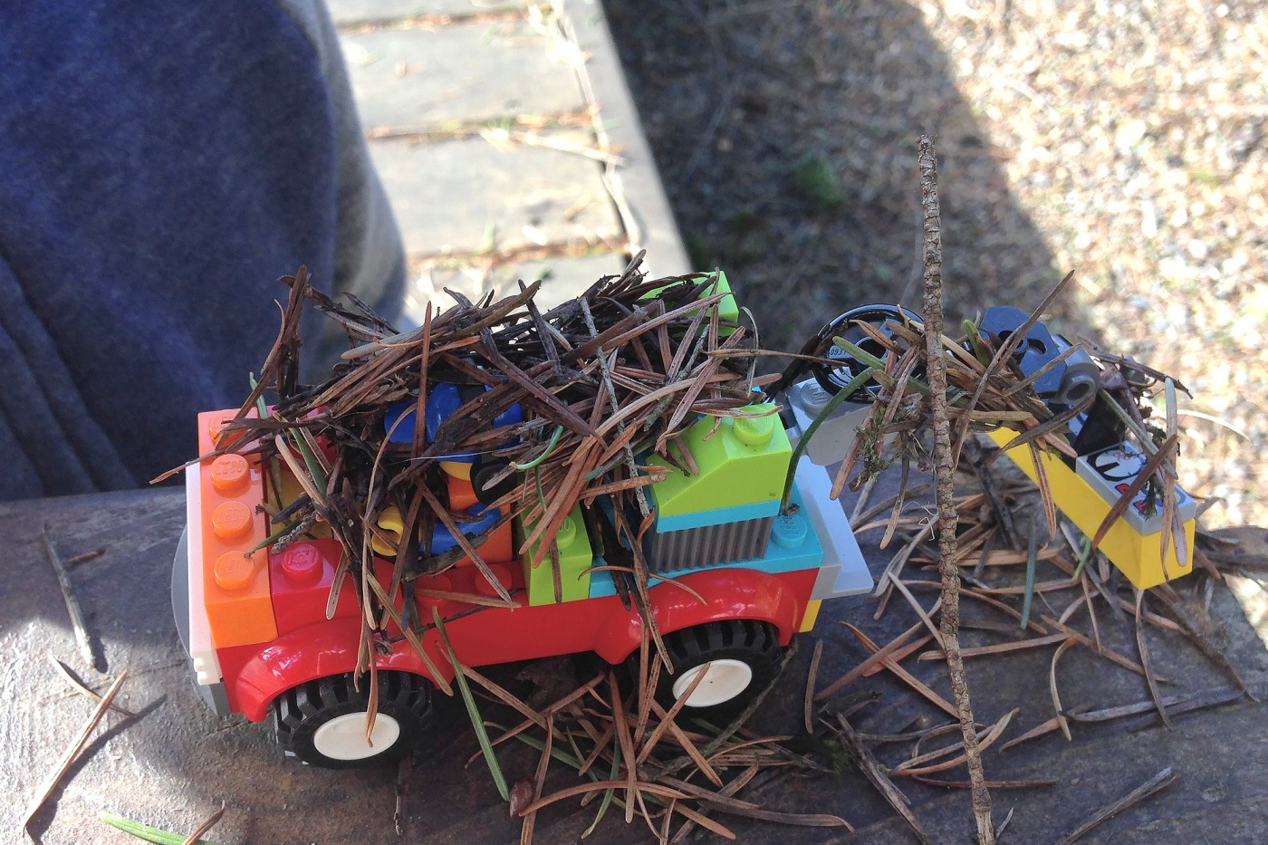 Lego Truck with many pine needles